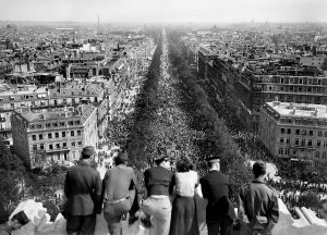 Picture dated of May 8, 1945 showing people looking at the crowded Champs Elysees Avenue from the Triumphal Arch (Arc de Triomphe) as Parisians gathered in the streets of Paris to celebrate the unconditionnal German capitulation at the end of the second World War.